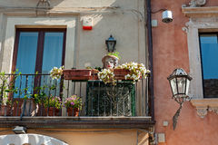 Balcony decorated with typical vases Stock Image