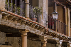 Balcony detail in the medieval village of Ayllón. Spain. They still resist the old timbers of the balcony of the medieval village of Ayllon. Segovia, Spain Stock Photo