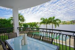 Balcony entertainment area of waterfront house. Balcony dining area of waterfront house on the canal Royalty Free Stock Photo