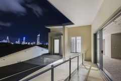 Balcony exterior of mansion with night views of skyline Stock Photography