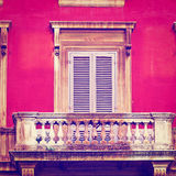 Balcony. Facade of the Old Italian House with Balcony in Rome, Instagram Effect Royalty Free Stock Image