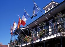 Balcony with flags, New Orleans. Royalty Free Stock Image