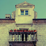 Balcony with flower pots in old european town Stock Image