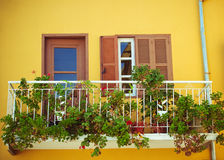 A balcony with flowers Stock Images