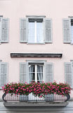 Balcony with flowers. Swiss balcony with flowers blooming Stock Photos