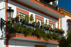 Balcony with flowers. Traditional spanish balcony with flowers Royalty Free Stock Photo