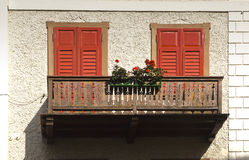 Balcony with flowers, Cortina dAmpezzo, Italy stock photos
