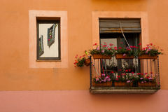 Balcony and flowers in Girona Spain. Typical balcony decorated with flowers in Girona Catalonia Spain Stock Image