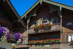 Balcony flowers on a house in Kochel, Bavaria. Balcony Flowers on a old House in Kochel am See, Kochelsee, Farmhouse, Bavaria, Upper Bavaria, Germany, Europe Royalty Free Stock Photography