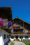 Balcony flowers on a house in Kochel, Bavaria. Balcony Flowers on a old House in Kochel am See, Kochelsee, Farmhouse, Bavaria, Upper Bavaria, Germany, Europe Stock Photo