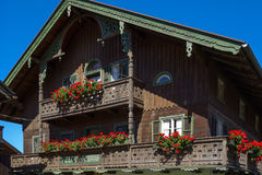 Balcony flowers on a house in Kochel, Bavaria. Balcony Flowers on a old House in Kochel am See, Kochelsee, Farmhouse, Bavaria, Upper Bavaria, Germany, Europe Stock Photos
