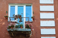 Balcony with flowers in an old House Royalty Free Stock Photo