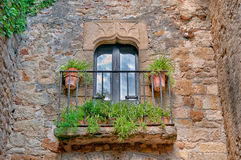Balcony with flowers, Peratallada, Spain Stock Photos