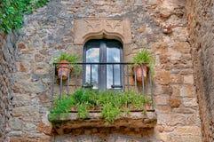 Balcony with flowers, Peratallada, Spain Stock Photos