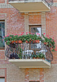 Balcony with flowers. Balcony with flowers in pots over brick wall stock photography
