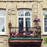 Balcony with flowers at summertime stock image
