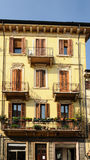 Balcony and flowers - typical view of Verona. Balcony with door in ancient building in Verona - Italy Stock Photo