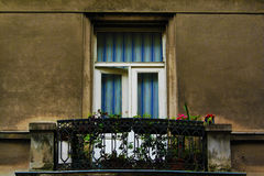 balcony with flowers and a window  downtown Zagreb building, Croatia, blue sky background Royalty Free Stock Photos