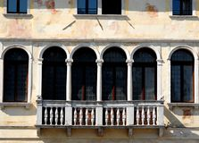 Balcony with four doors and twelve columns Stock Photography