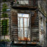 Balcony in front of abandoned house. Detail of balcony and facade of an abandoned house in the city royalty free stock photo