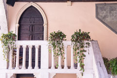 Balcony and front door minor of the medieval courthouse in Soave Stock Photos