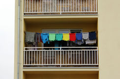 Balcony full of colorful T-shirts, drying washed clothes Royalty Free Stock Images