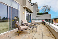 Balcony with furniture in new apartment building. Stock Images