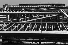 Balcony geometry in black and white. Lines and geometrical forms created by a steel balcony and fire escape ladders royalty free stock images