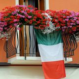 Balcony with Geraniums and the Italian flag Stock Photo
