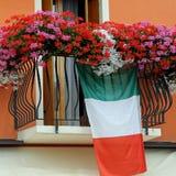 Balcony with Geraniums and the Italian flag Stock Photo