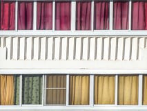 Balcony glazing with colourful textile curtains and architectura Royalty Free Stock Image