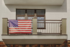 Balcony With Hanging American Flag On The Handrail. Horizontal Image Royalty Free Stock Photos