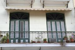 Balcony in Havana Cuba with ornate railing and long window panels Royalty Free Stock Image