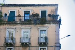 Balcony in a historic building in Catania, traditional architecture of Sicily, Italy royalty free stock image
