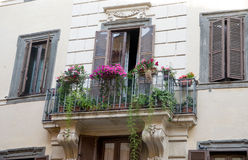 Balcony of historical building in the center of Rome. With flowers Stock Image