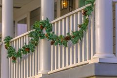 Balcony of home in Daybreak Utah with garland. Exterior of a home with garland on the railing of the balcony. Festive homes with Christmas decoration in royalty free stock photography