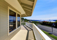 Balcony house exterior with wooden railings and perfect view. Royalty Free Stock Photo