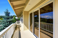 Balcony house exterior with wooden railings and perfect view. Stock Images