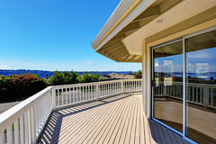 Balcony house exterior with wooden railings and perfect view. Royalty Free Stock Photos