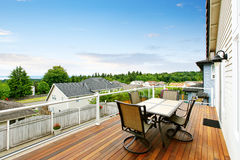 Balcony house with glass railings, table set and perfect view. Stock Photography