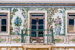 Balcony of a house with typical tiled of Portugal. Balcony of a typical house in Portugal, decorated with ceramics that have flowers, fruits and animals, in Royalty Free Stock Images