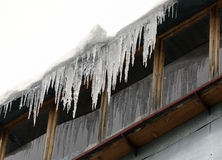 Balcony with icicles in the winter. Balcony with icicles with the snow in the winter stock photography