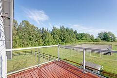 Balcony interior with picturesque view of the backyard. Balcony interior with picturesque view of the backyard on a sunny day royalty free stock images