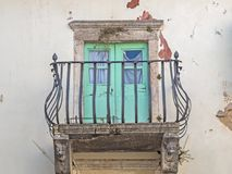 Balcony with iron balustrade at an old house in Croatia Stock Photos