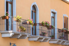 Balcony with iron railing in classic style. On Sardinia island, Italy Royalty Free Stock Photography