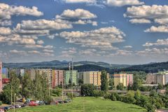 Balcony landspcace from prefab. Land-space from prefab balcony in Czech, clouds and hills with housing estate Stock Photography