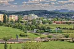 Balcony landspcace from prefab to trafic roundabout. Land-space from prefab balcony in Czech, clouds and hills with housing estate and traffic roundabout Stock Photo