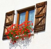 Balcony with large pots of Geraniums blooming 2 Stock Image