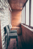 Balcony lodge interior in vintage nautical style decorated with wood planks and stone with big windows bar counter and bar chairs Royalty Free Stock Photography