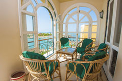 Balcony of a luxury villa with sea view. Chairs and table on balcony of a luxury villa in tropical resort with sea view stock images